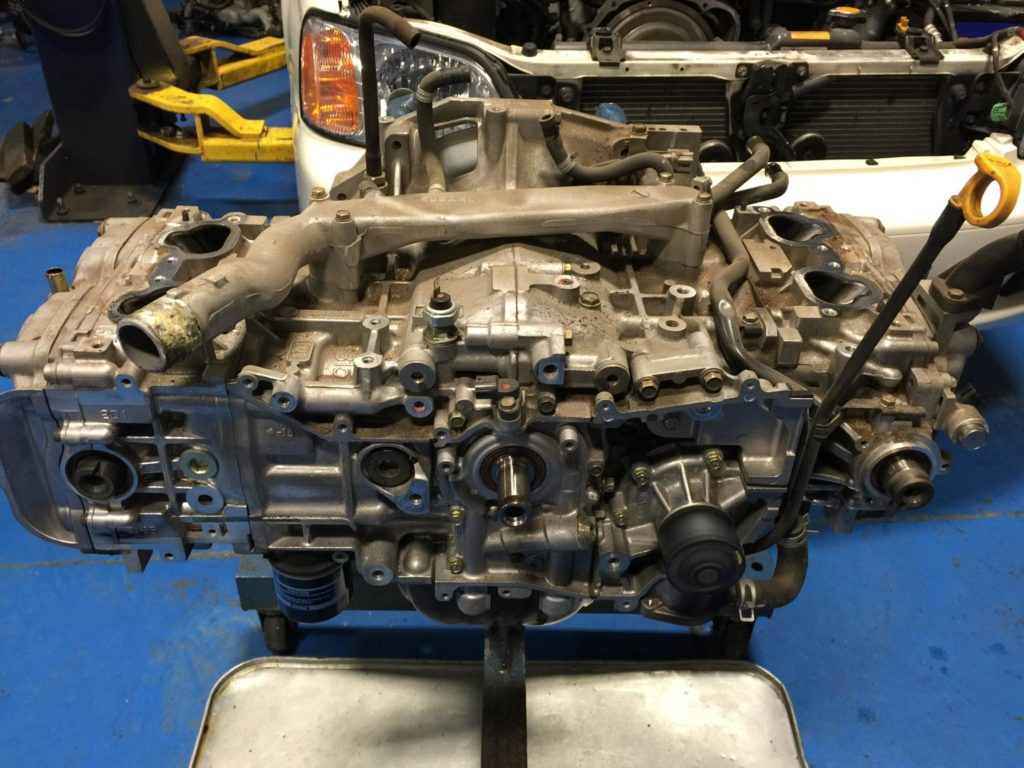 This is a pic of a Subaru engine with the intake manifold and timing belt components removed