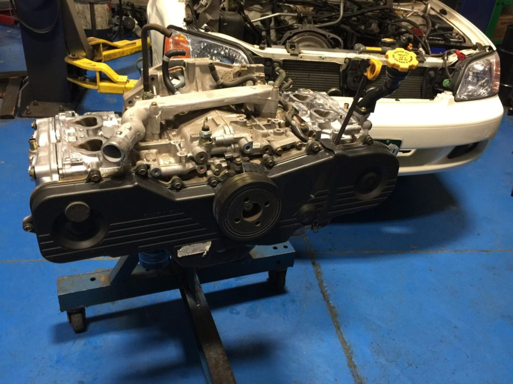 This pic shows the Subaru's engine with the cylinder heads and timing belt components reinstalled waiting for the intake manifold before finally putting the engine back in the car