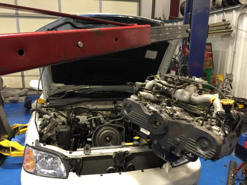 A Subaru's being removed for repair.